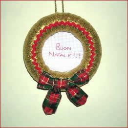 - Corone natalizie da appendere alla porta ...